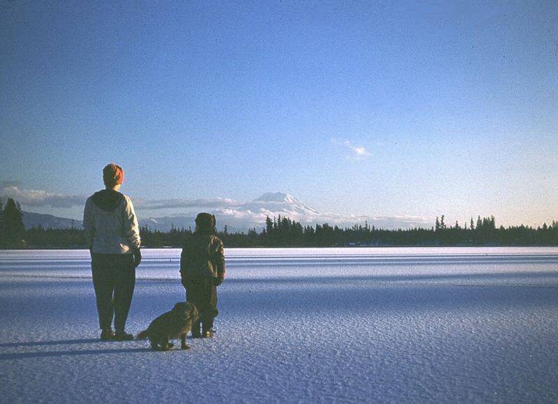 058 Ellen Sperry & son Jack on middle of frozen Lake Sawyer Jan, 1950