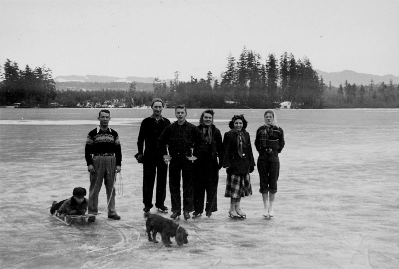 057A Lake Sawyer--Jack Spery & son Jack Jr. with friends on frozen lake, January, 1950